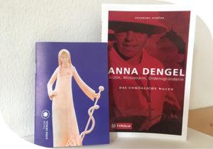 """Titelbild Taschenbuch """"Das Unmögliche wagen"""" und beigelegter Folder"""